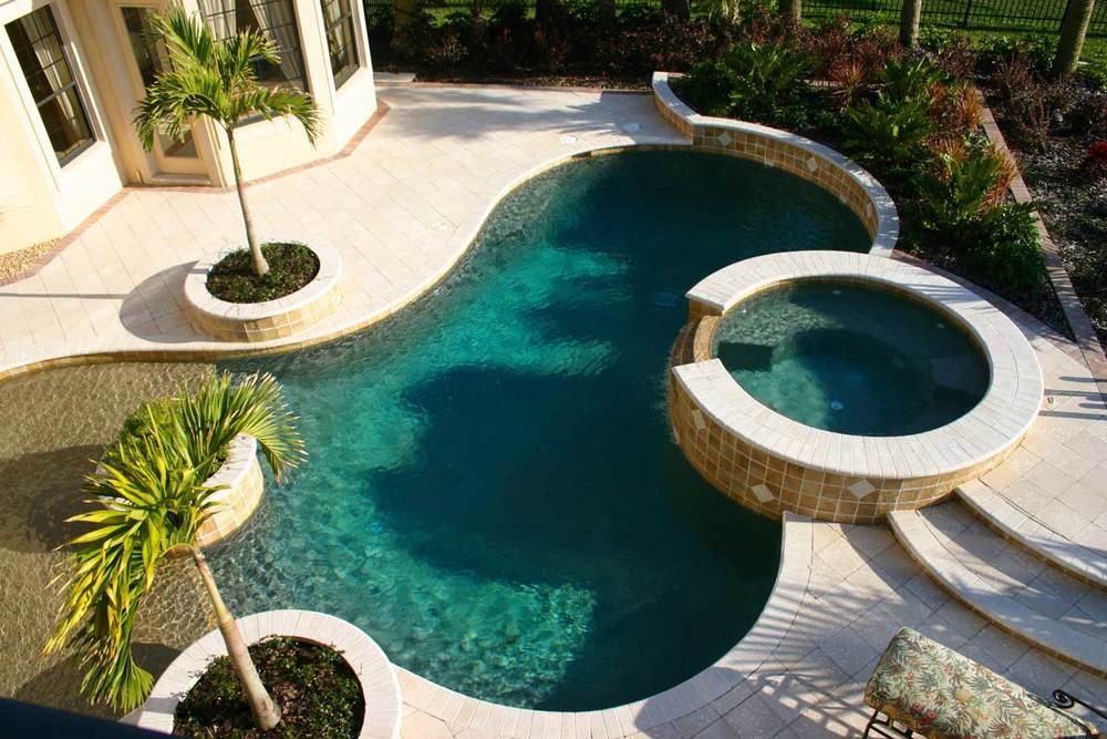 Make Your Pool More Relaxing with a Hot Tub