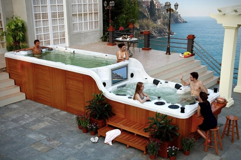 Make Your Pool More Relaxing with a Hot Tub Picture